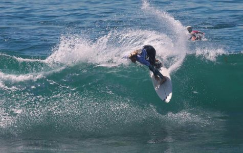 Surfer wins first in longboard and short board competition