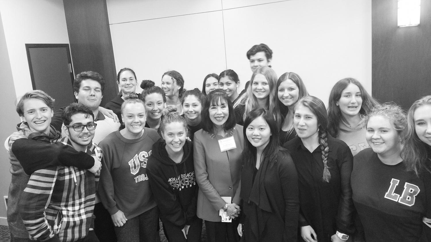 APUSH students gather with Karen Korematsu after the presentation. Students were encouraged to enter the competition for personal experience and the chance to learn more about democracy, the legal system and the reality about Japanese internment.