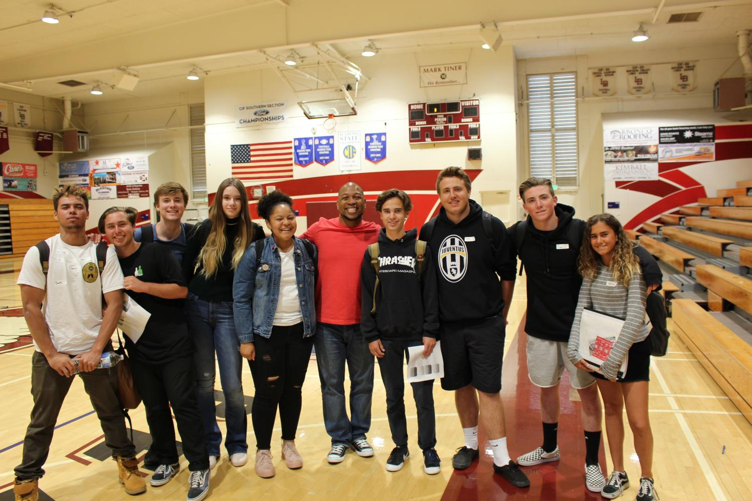 (Left to Right) Henry Syvertsen, Ethan Kavandi, Willie Shea, Kendall Fraser, Avalon Brice, Keith Hawkins, Garret Robben, Gustav Morck, Sean Decker, and Jessica Berk unite enthusiastically after the leadership assembly. This marked the second visit of Keith Hawkins to our campus this school year.