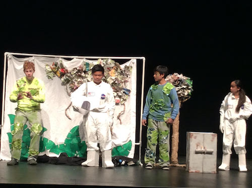 Laguna Beach Code Breakers, from left to right: Kyle Herkins, Andrew Duong, Kenneth Chu, and Isabel Duong perform original skit in Tennessee for Destination Imagination Global Finals tournament. They acted in front of a panel of judges and audience for eight minutes.