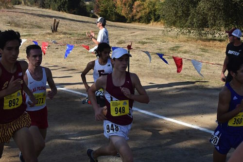 Ryan Smithers gives it his all as he pushes to the front of the pack in the Division IV boys race at Woodward Park.
