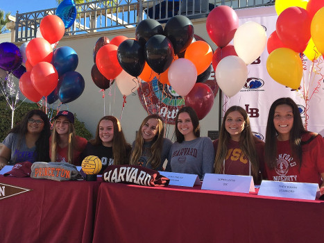 (Left to right) Danielle Borelli, Kyla Whitelock, Isabel Riches, Alana Evans, Evan Tingler, Sophia Lucas, and Thea Walsh sign to their colleges in the quad on signing day. They have broken a school record for the most seniors from a single team to sign to colleges.
