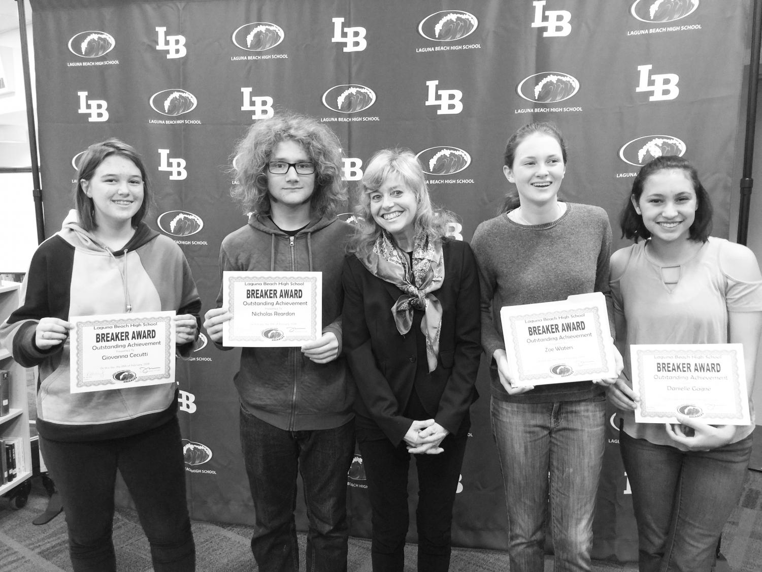 (Left) Giovanna Cecutti, Nick Reardon, Zoe Waters, and Danielle Gagne celebrate their successes in French in both Madame Randi Beckley's and Madame Odile Dewar's French classes.  (Right) Izzy Saunders receives a Breaker Award from her Global Studies teacher Jennifer Lundblad.  Teachers and students related how appreciative they were that the new awards format felt more personal and meaningful than the previous structure.