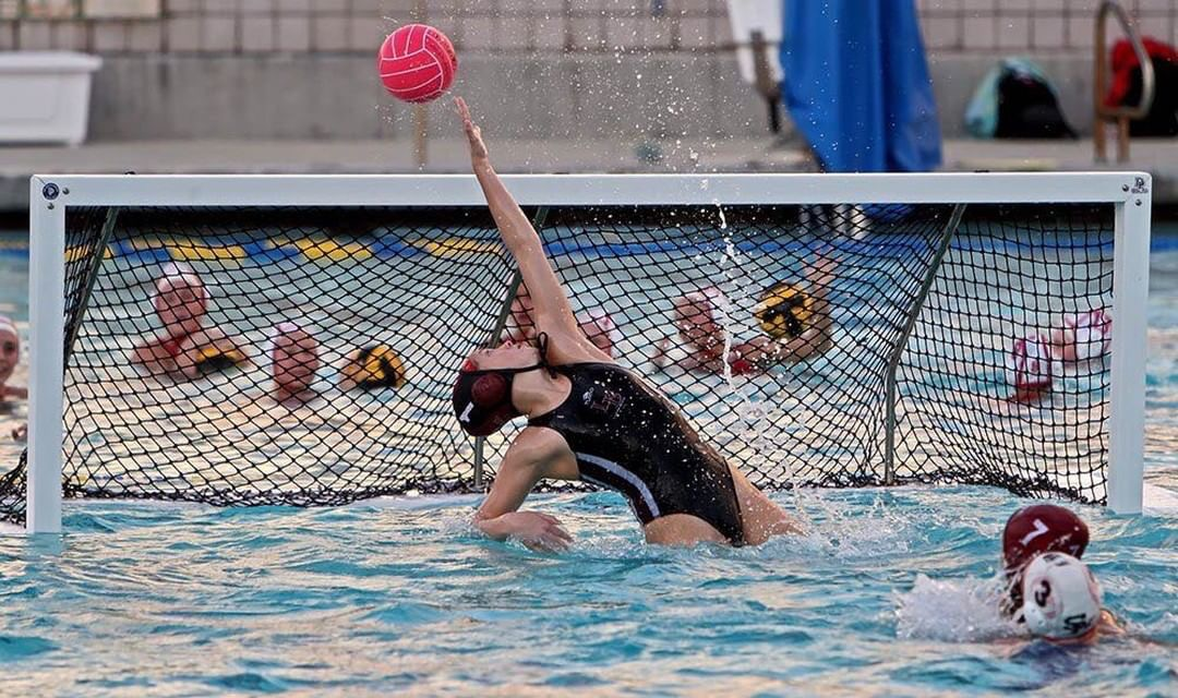Senior goalkeeper Quinn Winter contorts her body as she makes a fantastic save. Quinn has been a leader for the team as well always being someone the team can count on to make a key save.