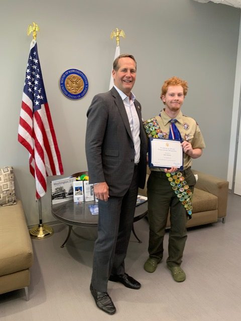 Kyle Herkins is commemorated by Congressman Harley Rouda for earning all the merit badges.  (Take by: Lisa Herkins)