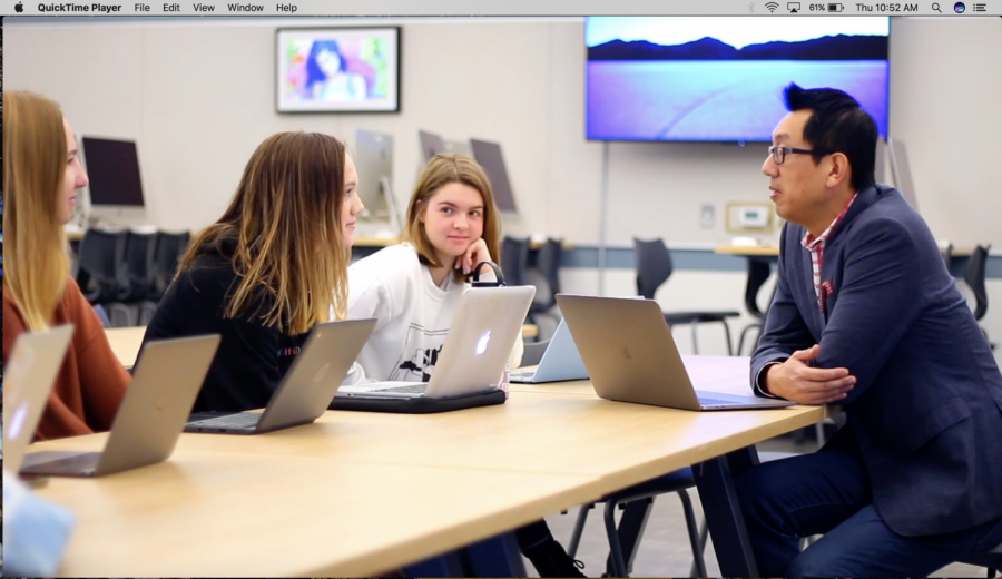 Julia Henry and Abby Amish discuss the class with AER instructor Jun Shen. Students had the opportunity to connect with their mentors at the welcome breakfast in September.