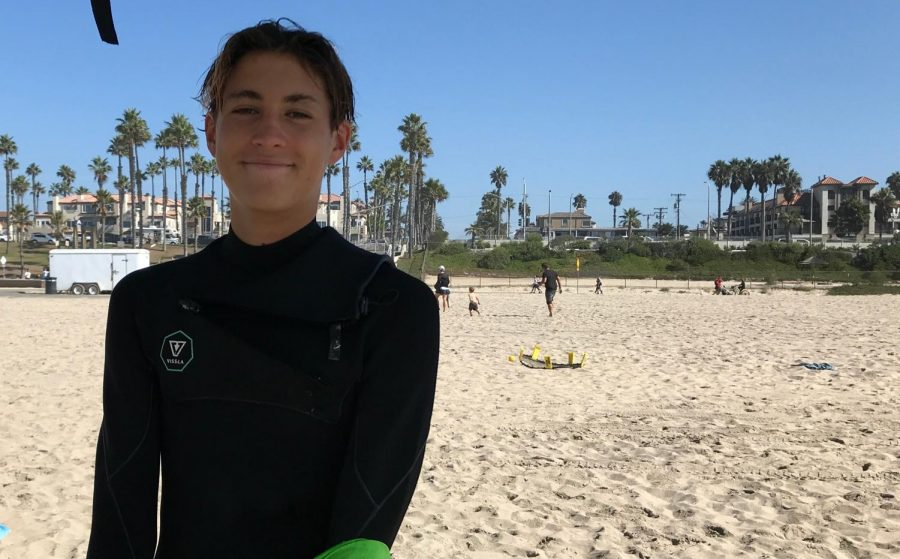 Gavin Pike stands on the beach awaiting a surf competition. Pike's involvement in the surf team gave him the skills necessary to save the mother and son from the rip current.